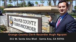 orange county clerk-recorder standing by sign